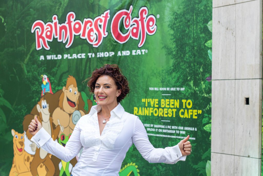 Clare Agius with the hoarding of Rainforest Cafe restaurant in St Julians'